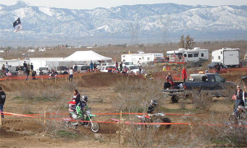 A motorcycle race at the base of a mountain area
