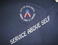 Service Above Self emblazoned on cloth